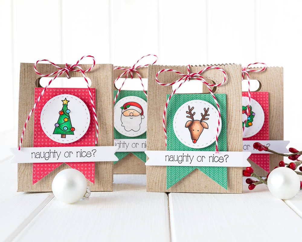 Mini gift bags tutorial. For more please visit http://limedoodledesign.com/2014/11/mini-treat-bags-tutorial/ Debby Hughes - Lime Doodle Design - #gift #bag #christmas #tag