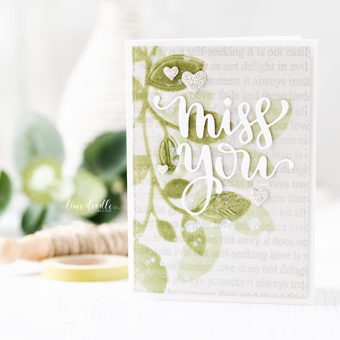 Brush stencilled background of leaves for this Miss You card by Debby Hughes. Find out more about this card by clicking on the following link: http://limedoodledesign.com/2017/02/brush-stencilled-background/