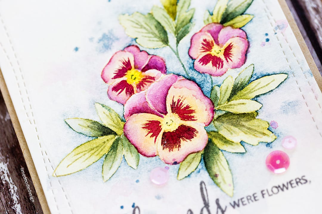 Watercoloured pansies handmade card by Debby Hughes using the Clearly Besotted Pretty Pansies set. Find out more here: http://limedoodledesign.com/2017/11/watercoloured-pansies/