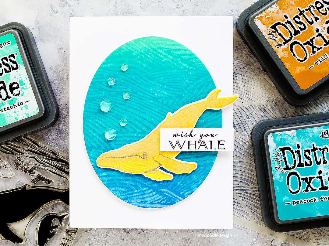 Lifting Distress Oxide with water. Handmade fun whale cards by Debby Hughes. Find out more here: http://limedoodledesign.com/2018/03/video-lifting-distress-oxides/