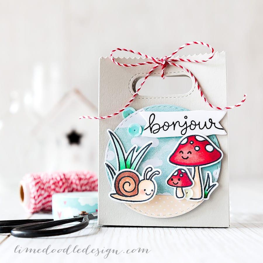Debby Hughes - Lime Doodle Design https://limedoodledesign.com/2015/03/bonjour/ #lawnfawn #giftbag