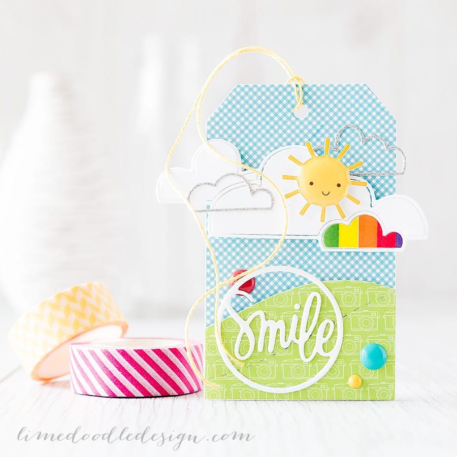 Bringing a little sunshine with this cute tag. Debby Hughes - Lime Doodle Design https://limedoodledesign.com/2015/05/june-card-kit-smile-tag/ #tag #summer #sun #smile
