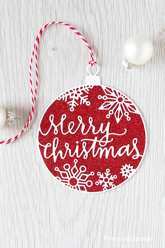 Die cut overlay - this Christmas Ornament die is one of the most outstandingly gorgeous and intricate dies I've seen. Find out more by clicking here: https://limedoodledesign.com/2015/09/stamptember-die-cut-overlay/
