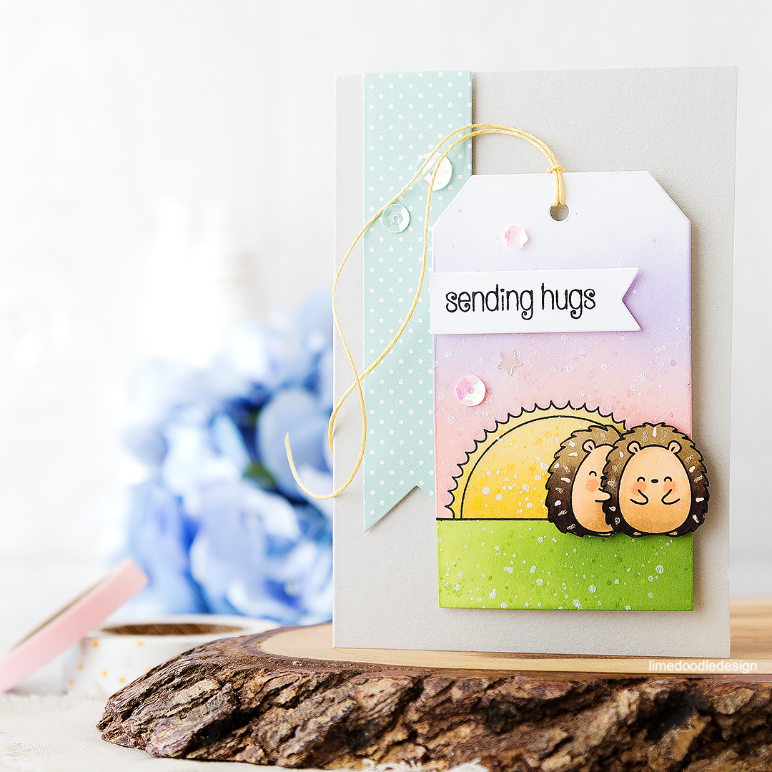 Do hedgehogs give prickly hugs? Sending hugs card - these cute Copic colored critters adorn a tag packed with ink blending and soft colors. Find out more by clicking on the following link: https://limedoodledesign.com/2016/07/hedgehogs-give-prickly-hugs-wonder/