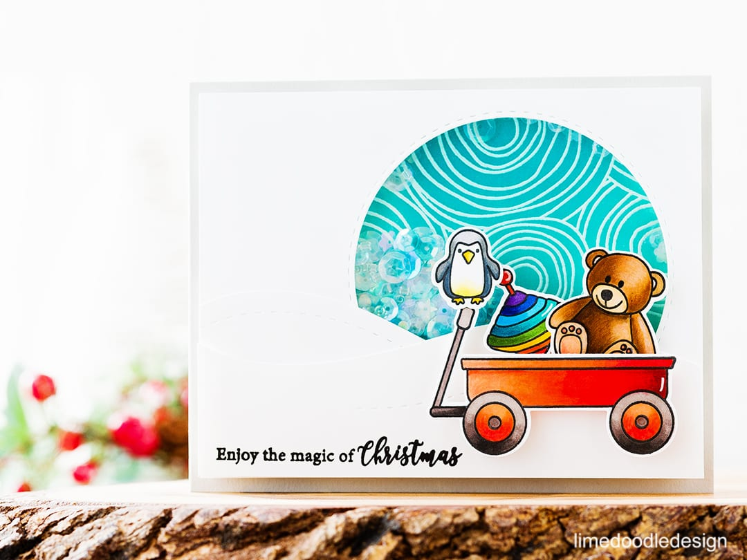 Christmas Shaker Card - I'm shakin' it up for the Caring Hearts Card Drive blog hop! Find out more by clicking on the following link: https://limedoodledesign.com/2016/11/shakin-it-up-for-the-caring-hearts-card-drive-hop-giveaway/