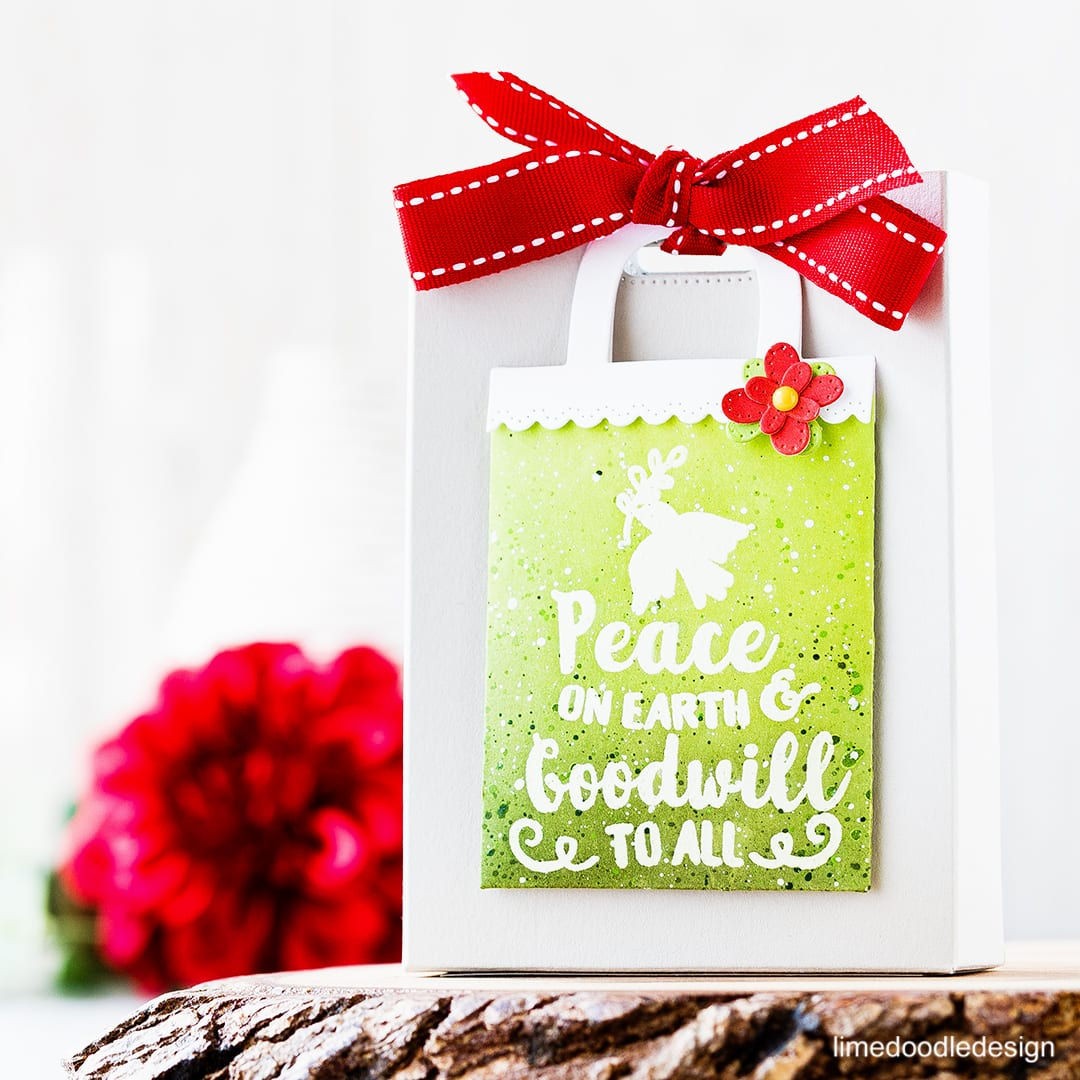 Video step by step tutorial of creating this gift bag duo. Find out more about these Christmas gift bags by clicking on the following link: https://limedoodledesign.com/2016/11/video-gift-card-pocket-gift-bag/