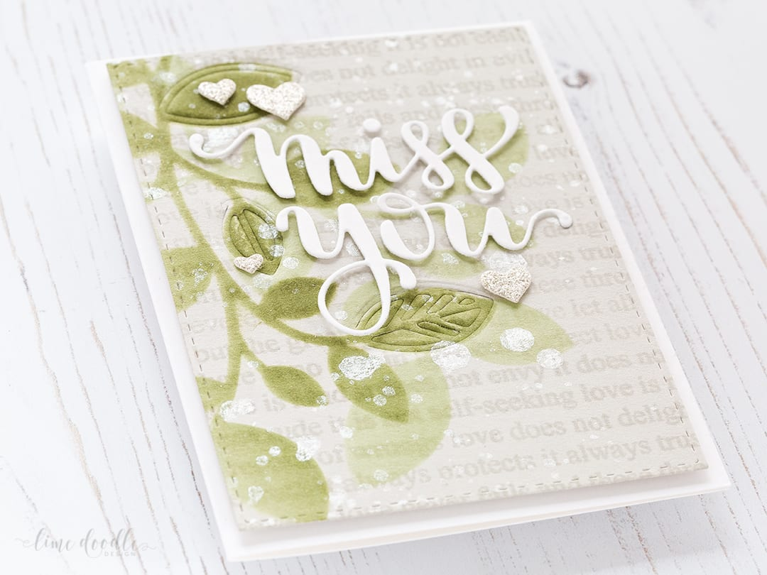 Brush stencilled background of leaves for this Miss You card by Debby Hughes. Find out more about this card by clicking on the following link: https://limedoodledesign.com/2017/02/brush-stencilled-background/