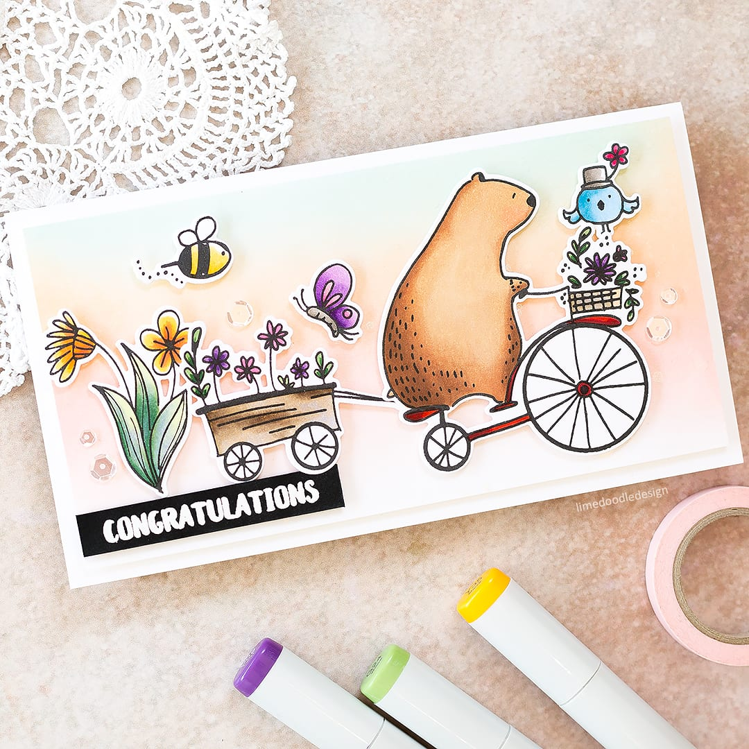 Copic colouring video tutorial by Debby Hughes using the Waffle Flower and Big Bear & Bird Happy Day stamp set. Find out more about this card by clicking on the following link: https://limedoodledesign.com/2017/03/video-copic-colouring-ink-blended-background/