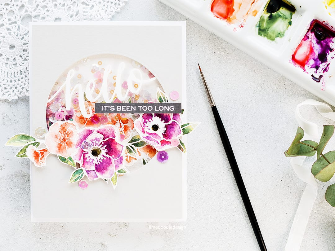 Watercoloured shaker card by Debby Hughes using Wplus9 Kind Soul set. Find out more about this shaker hello card by clicking on the following link: https://limedoodledesign.com/2017/04/video-watercoloured-shaker-card/