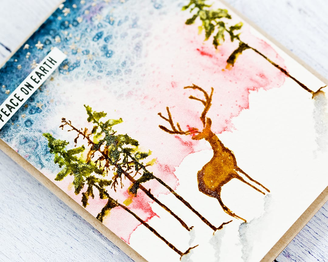 Watercoloured Holiday handmade card and stamped Holiday tag by Debby Hughes using the new Tim Holtz Stampers Anonymous STAMPtember 2017 stamp and stencil set. Find out more here: https://limedoodledesign.com/2017/09/tim-holtz-stampers-anonymous-stamptember-winner/