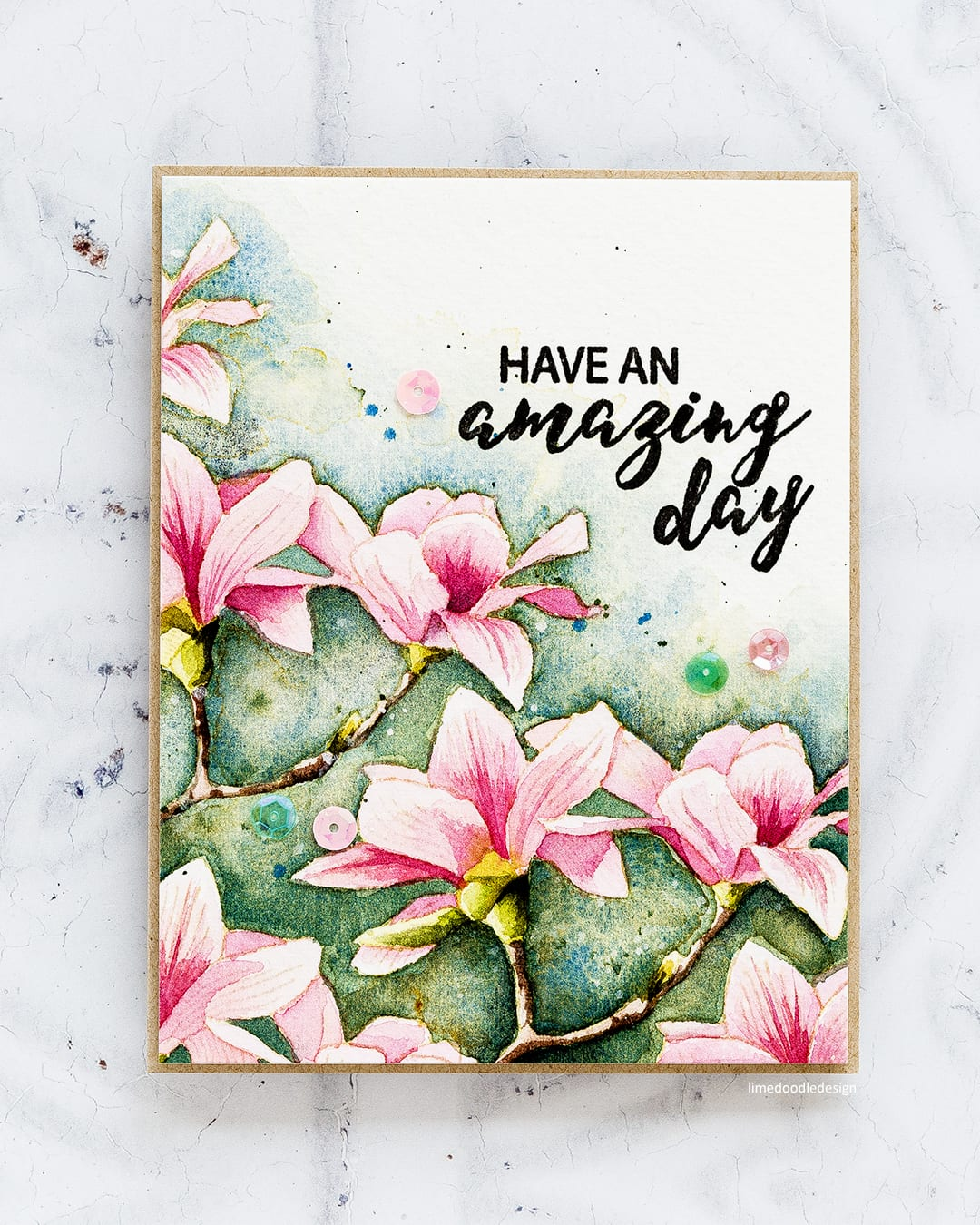 No-line watercoloured handmade magnolia flower card by Debby Hughes using the Build A Flower Magnolia set from Altenew. Find out more here: https://limedoodledesign.com/2017/10/watercoloured-magnolias/