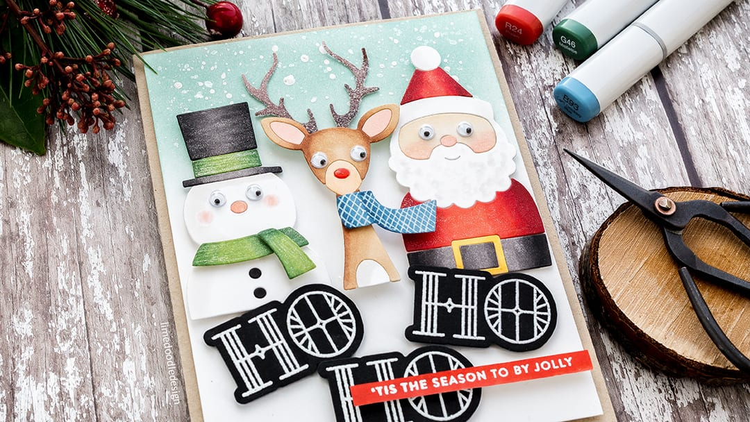 No line die cutting for this super cute handmade Christmas card by Debby Hughes using the Picture Book die series from Simon Says Stamp . Find out more here: https://limedoodledesign.com/2017/11/ho-ho-ho-no-line-die-cutting/