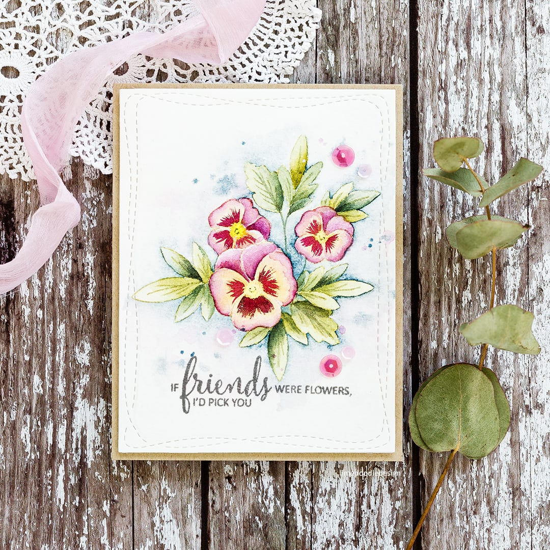 Watercoloured pansies handmade card by Debby Hughes using the Clearly Besotted Pretty Pansies set. Find out more here: https://limedoodledesign.com/2017/11/watercoloured-pansies/