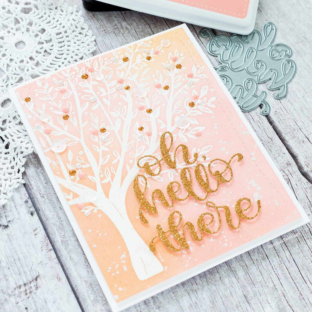 Delicately blended inks over a white heat embossed tree. Handmade card by Debby Hughes using the Brushed Branches set from Simon Says Stamp. Find out more here: https://limedoodledesign.com/2018/01/pastel-tree/