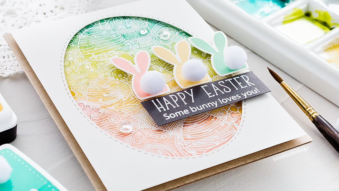 Watercolour emboss resist cute bunny handmade Easter card by Debby Hughes. Find out more here: https://limedoodledesign.com/2018/03/video-watercolour-emboss-resist-cute-easter/