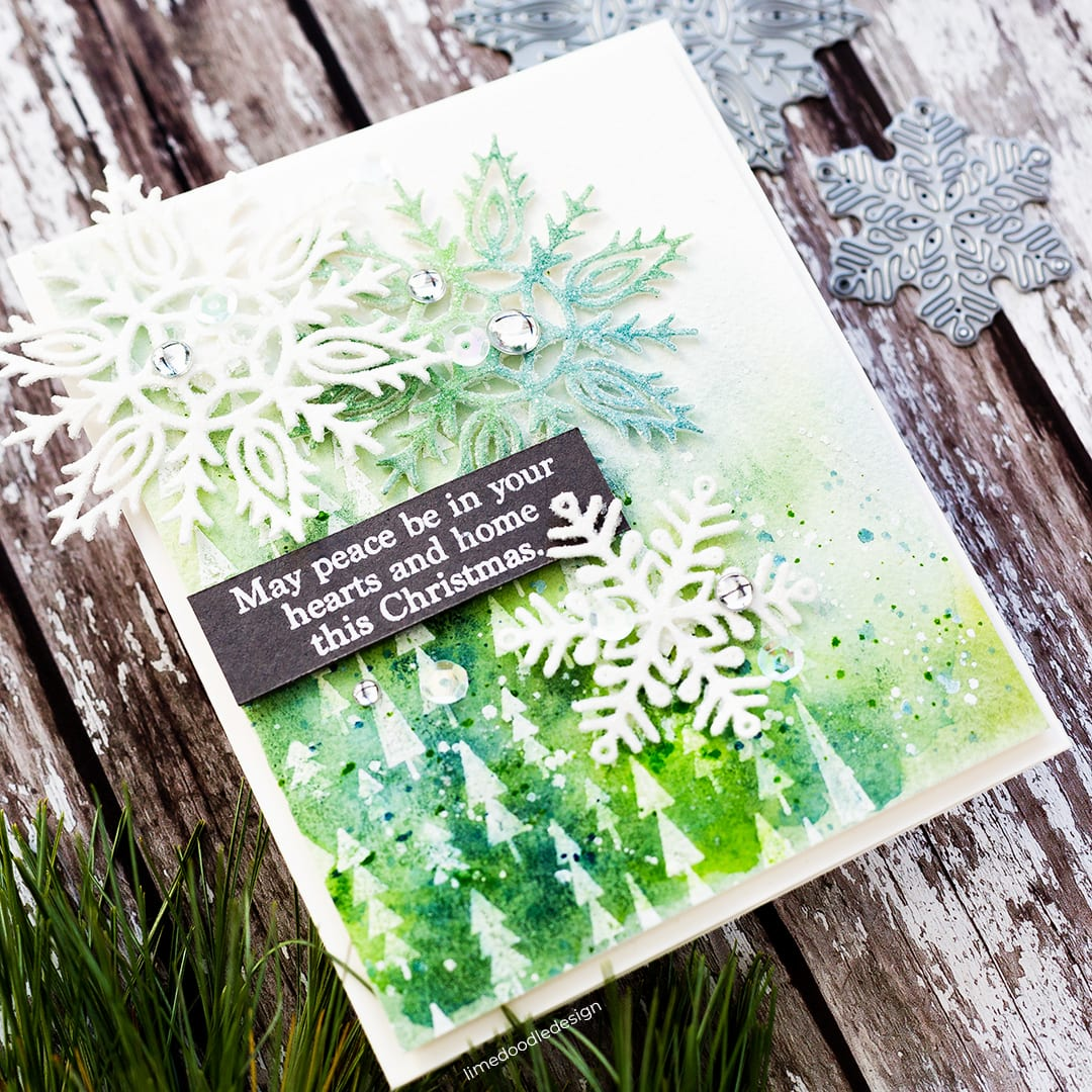 Winter forest watercoloured snowy scene Christmas card by Debby Hughes using supplies from Simon Says Stamp. Find out more here: https://limedoodledesign.com/2018/10/snowy-forest-blog-hop-giveaway/