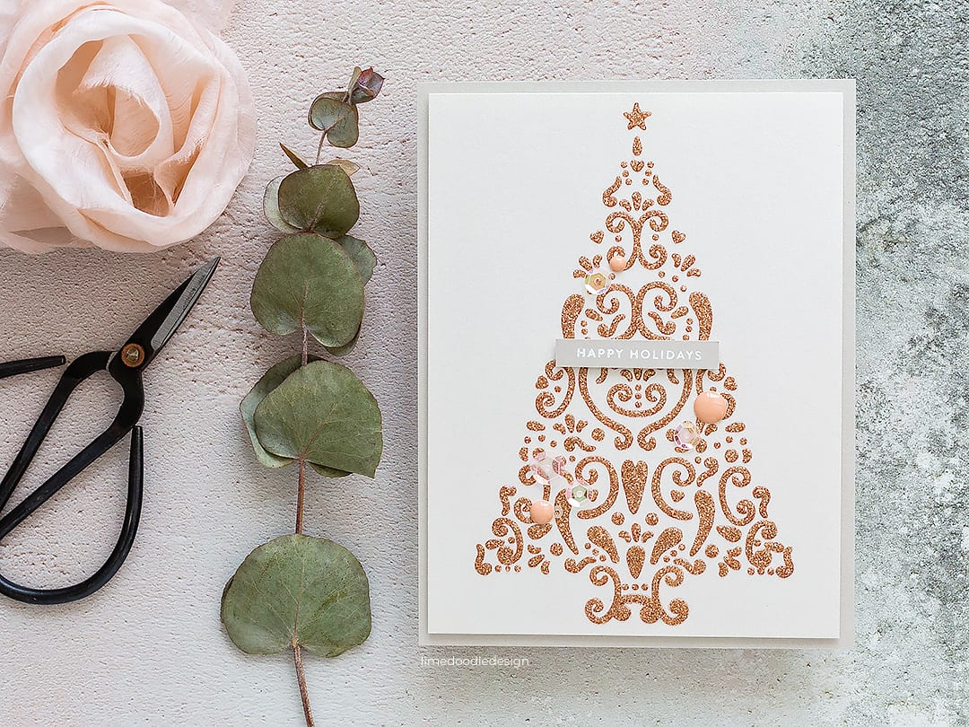 Video - super clean and simple, easy to mass produce handmade Christmas card by Debby Hughes using supplies from Alexandra Renke, Bo Bunny and Simon Says Stamp. Find out more here: https://limedoodledesign.com/2018/11/video-super-clean-simple-easy-to-mass-produce-christmas-card/