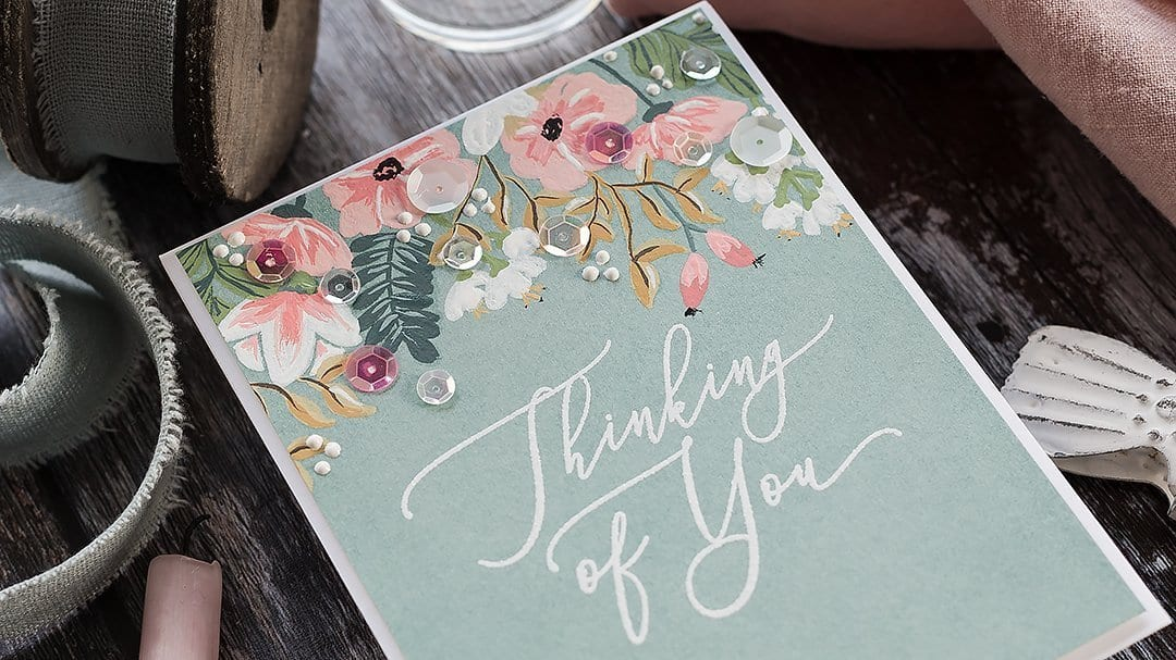 Video tutorial using white gouache mixed with traditional watercolours to paint over a coloured background. Handmade thinking of you card by Debby Hughes using supplies from Simon Says Stamp. Find out more here: https://limedoodledesign.com/2018/12/video-gouache-watercolour-painted-flowers-giveaway/