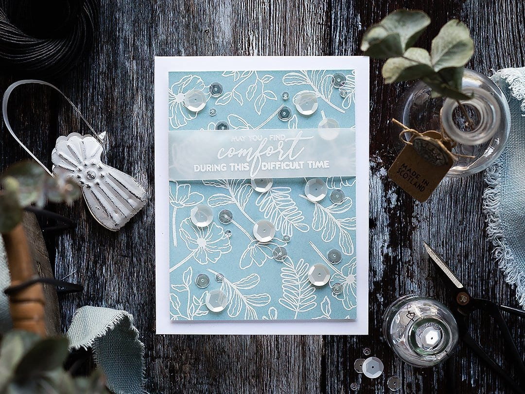 Simple white embossed flower pattern on ink blended blue background with vellum sentiment strip. Handmade card by Debby Hughes using supplies from Simon Says Stamp. Find out more here: https://limedoodledesign.com/2019/01/simple-white-embossed-flowers/