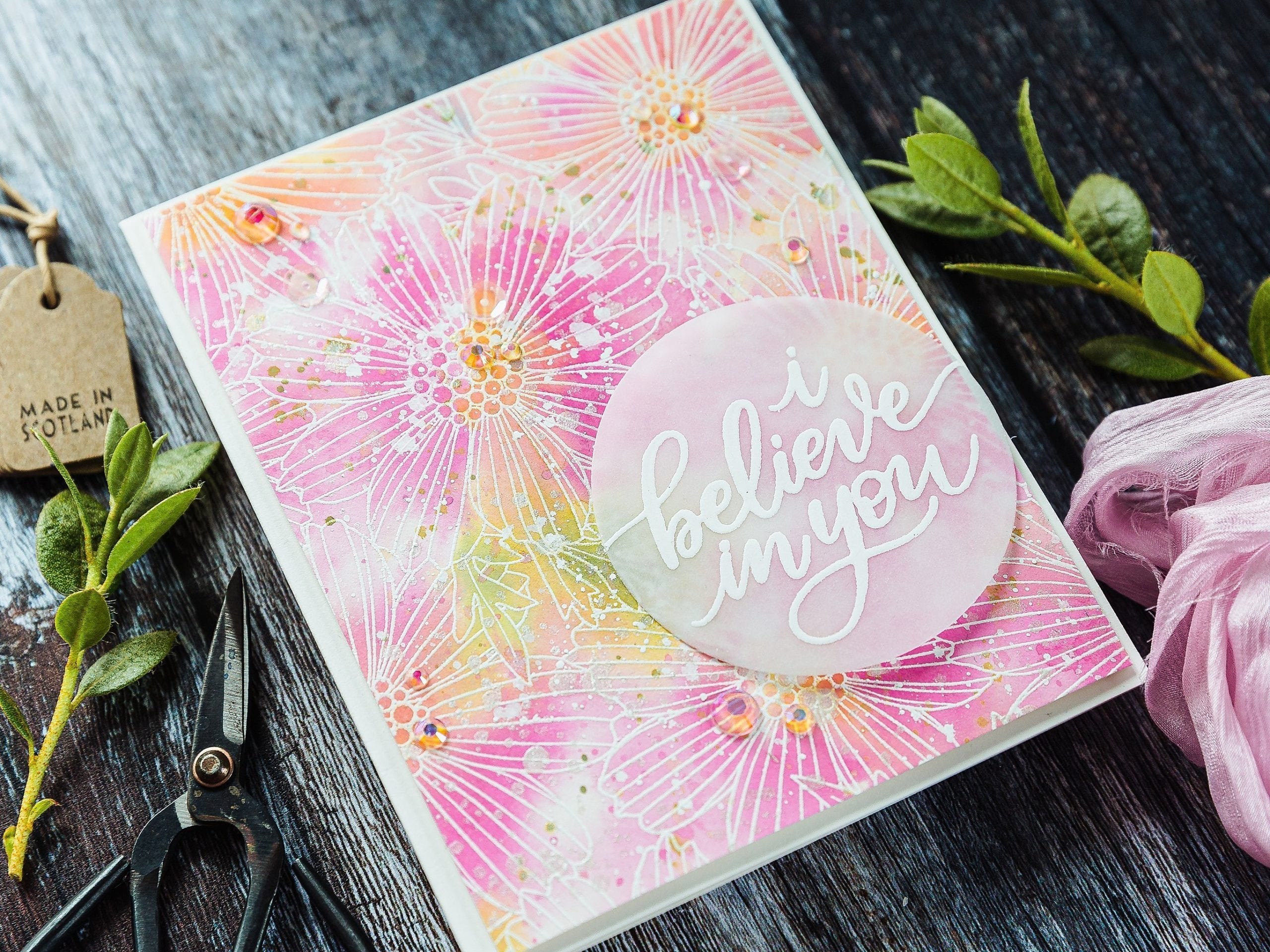 Simple watercoloured look using Distress Oxide sprays - handmade floral vellum encouragement card by Debby Hughes using supplies from Simon Says Stamp. Find out more here: https://limedoodledesign.com/2019/07/distress-oxide-spray-watercolour-background/