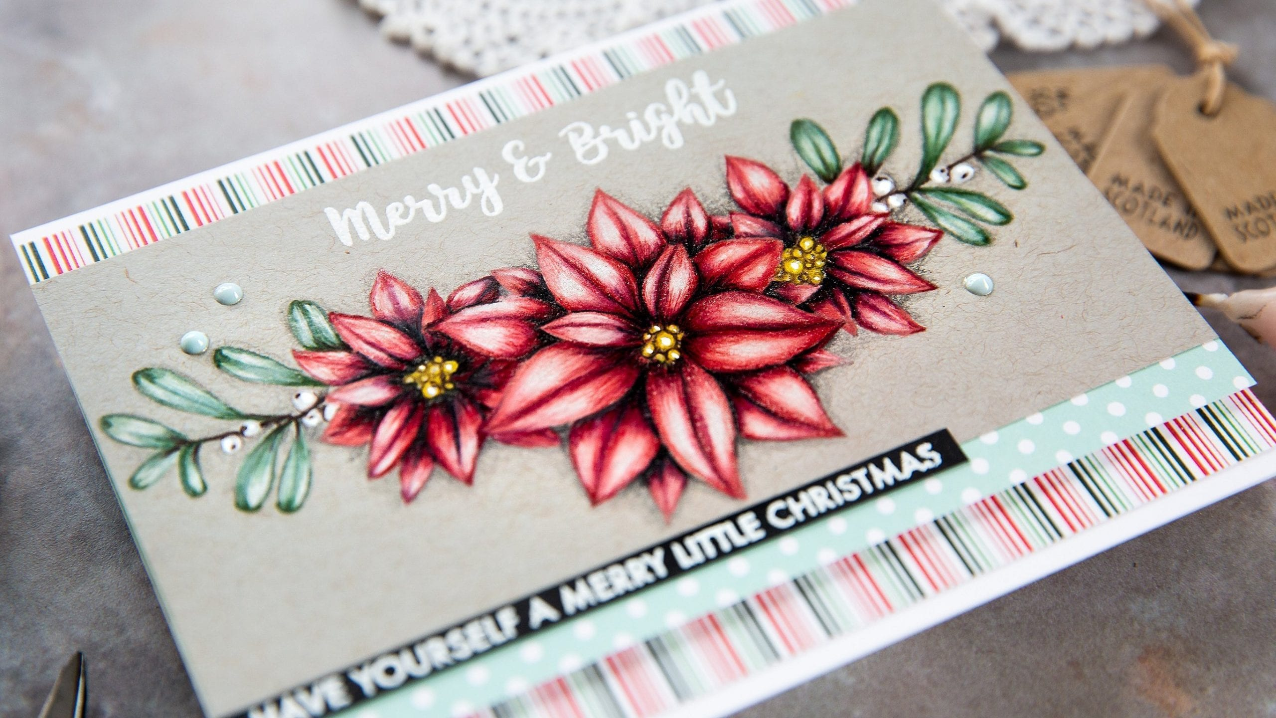 Video - pencil colouring poinsettias. Handmade Holiday Christmas card by Debby Hughes using supplies from Paper Rose. Find out more here: https://limedoodledesign.com/2019/09/video-paper-rose-stamptember/