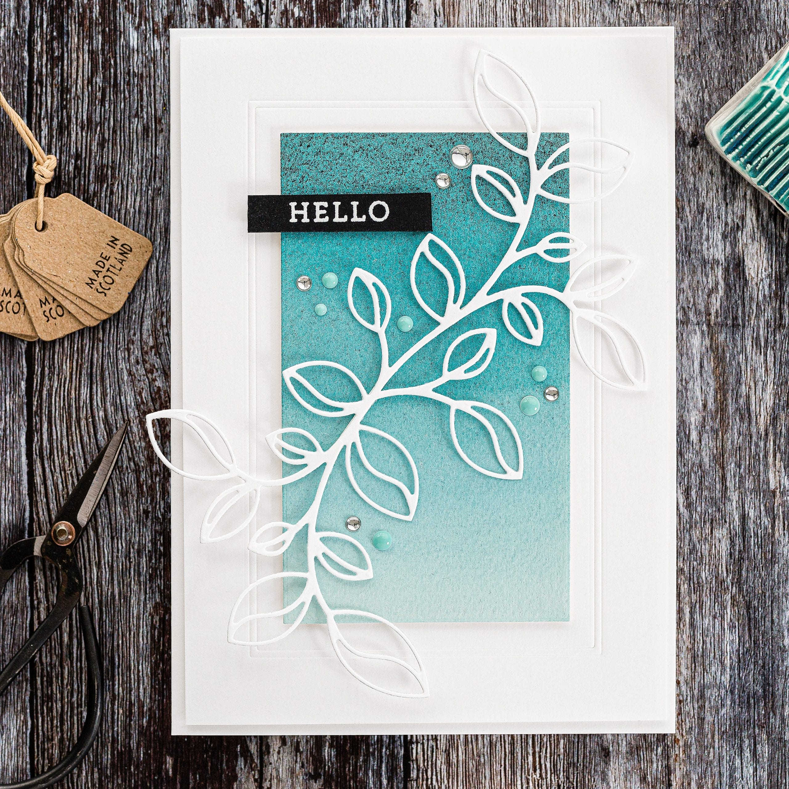 Clean and simple white layers to showcase a beautiful Detailed Leaf Cluster die from Simon Says Stamp. Handmade card by Debby Hughes.