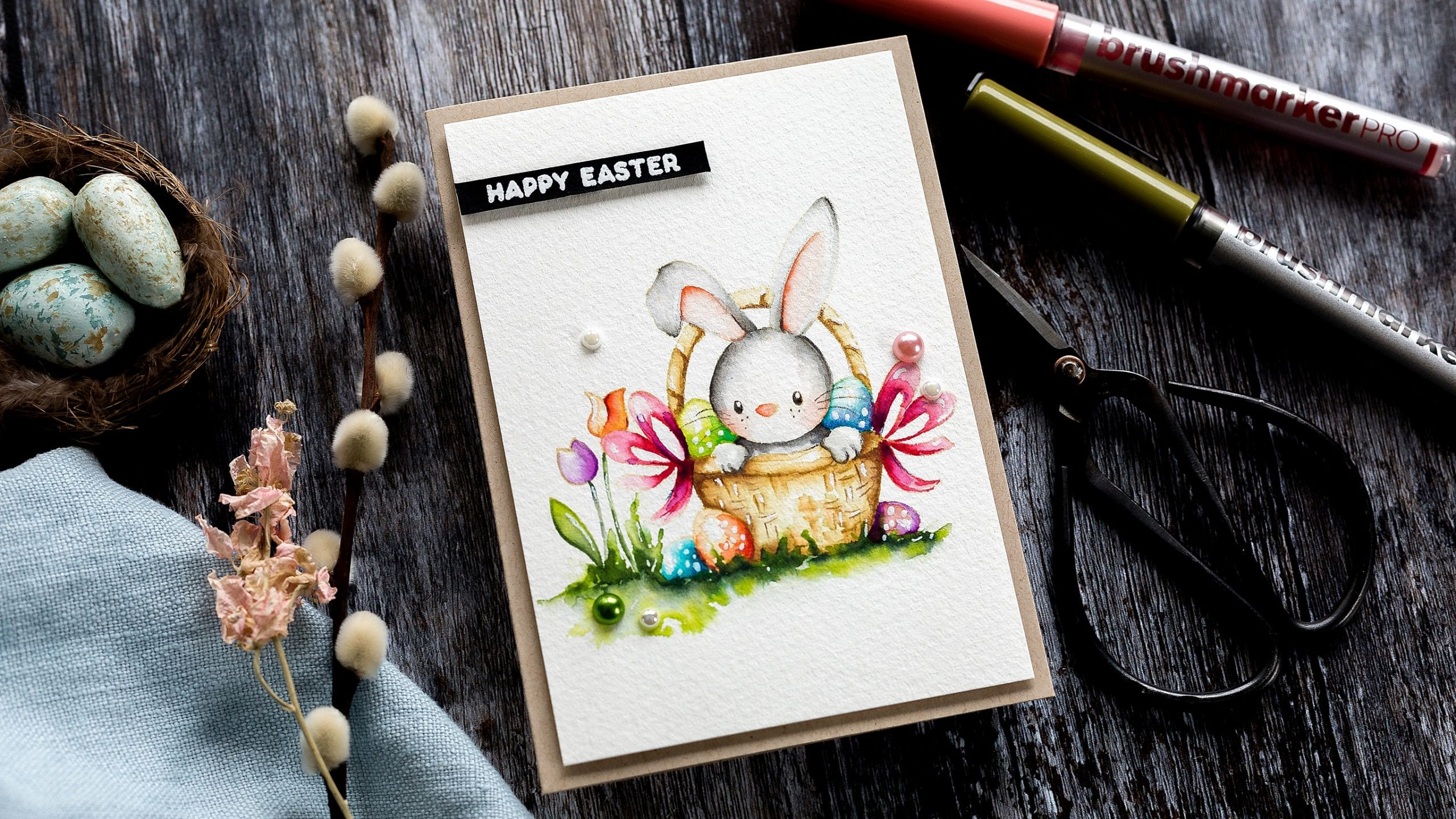 Video tutorial Karin Brushmarker Pro pens and Fabriano Artistico Extra White Cold-Pressed watercolour card review watercolouring a cute handmade Easter rabbit in a basket card by Debby Hughes #watercolor #tutorial #homemade