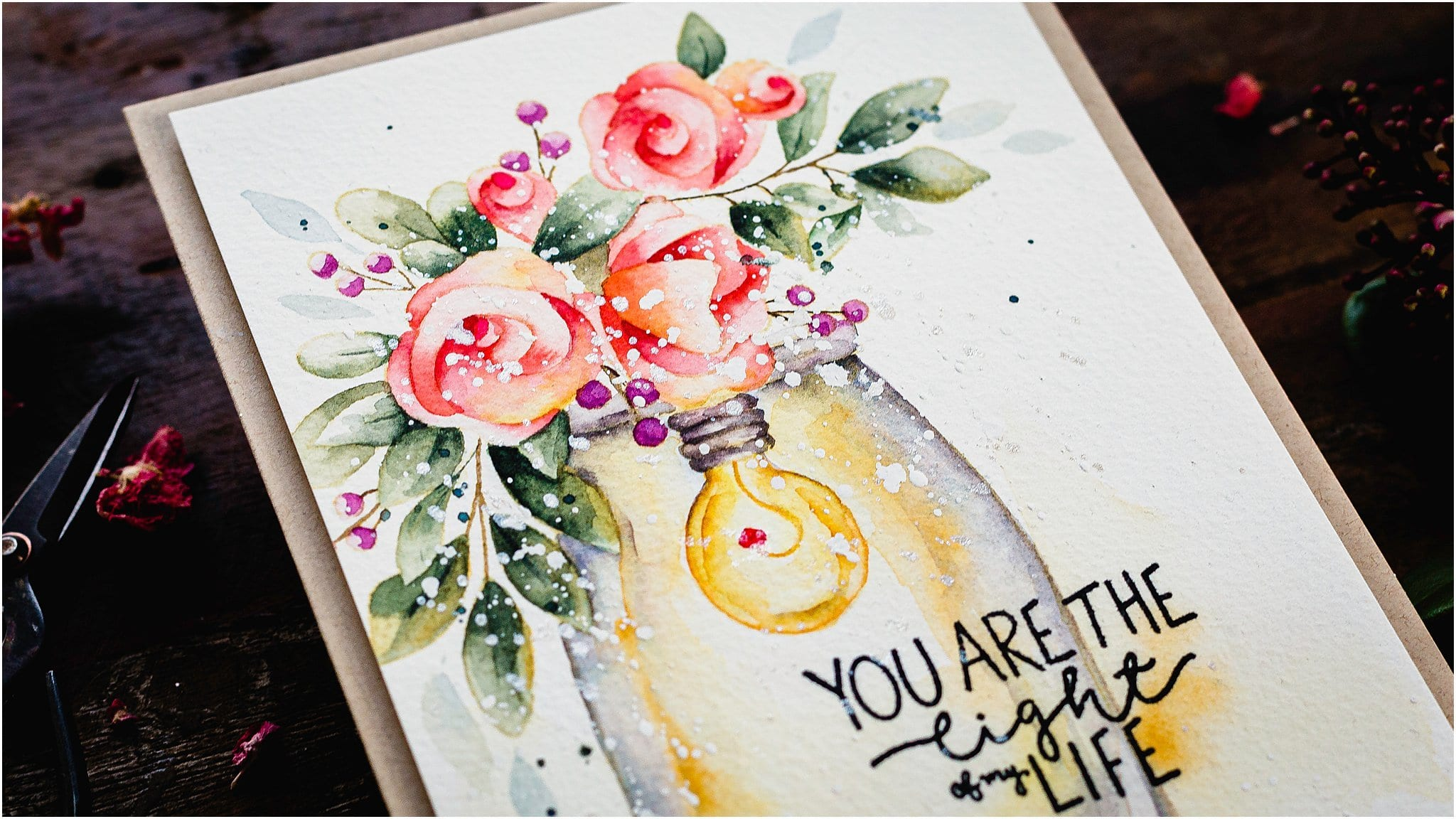 Video tutorial on how to watercolour glass on this handmade card by Debby Hughes with both a glass jar and a glass lightbulb to think about! #handmadecards #cardmaking #cardmakingideas #cardmakingtechniques  #cardmakingtutorials #handmadecardideas
